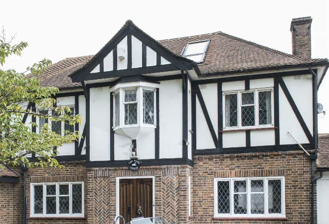 A large Tudor style listed house with discreet secondary double glazing on hinged casement windows