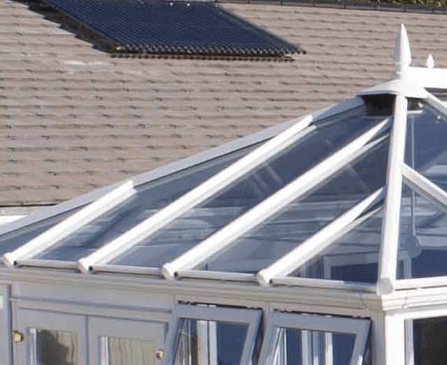 Everest conservatory replacement roof with white frames
