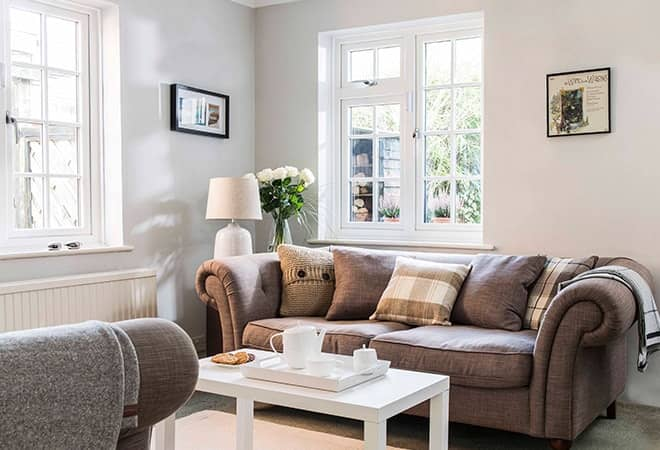 Everest white upvc windows viewed from the interior of a contemporary furnished living room