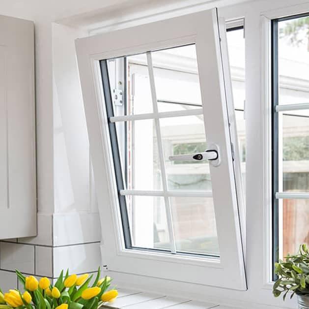 Everest tilt and turn upvc window tilted open in white with flowers