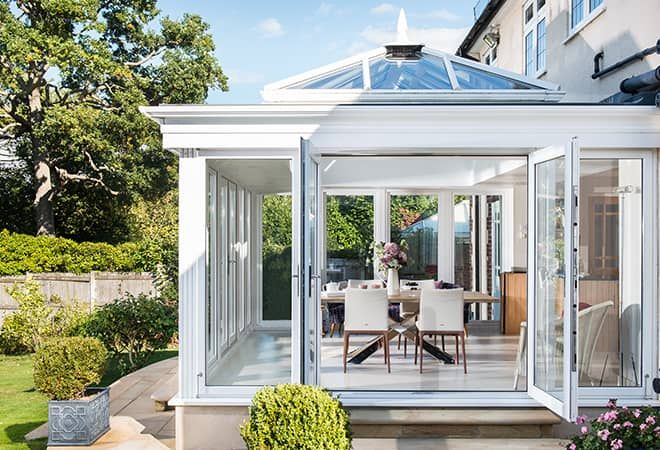 A beautiful glass extension with white uPVC trim to illustrate the added value that makes the conservatory cost of an Everest project so worth wild.