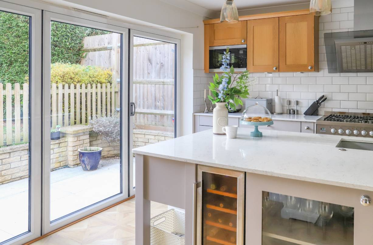 A kitchen with aluminium bi-fold doors