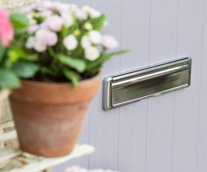 Close up of an chrome letterbox on an Everest entrance door which are available in a wide range of styles, materials and colours