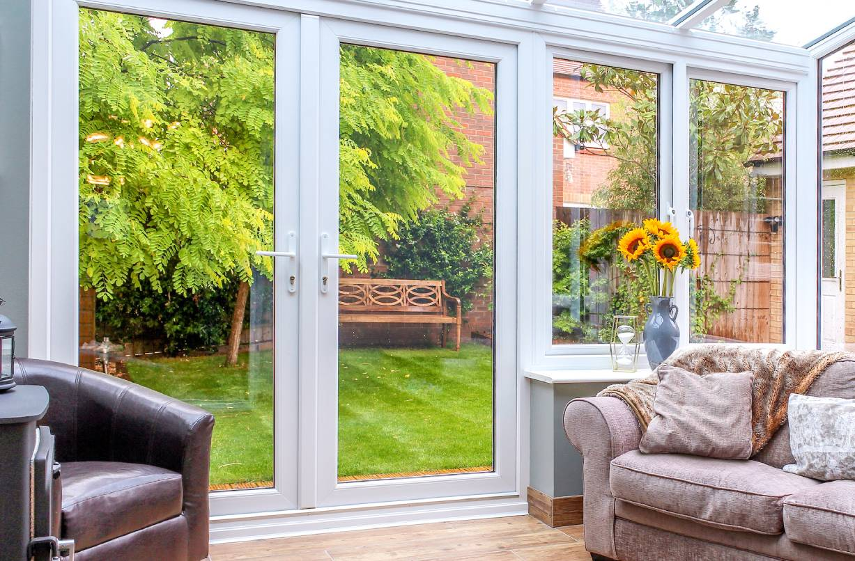 White uPVC French doors in a conservatory