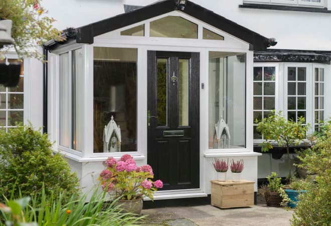 An Everest porch with black composite entrance door