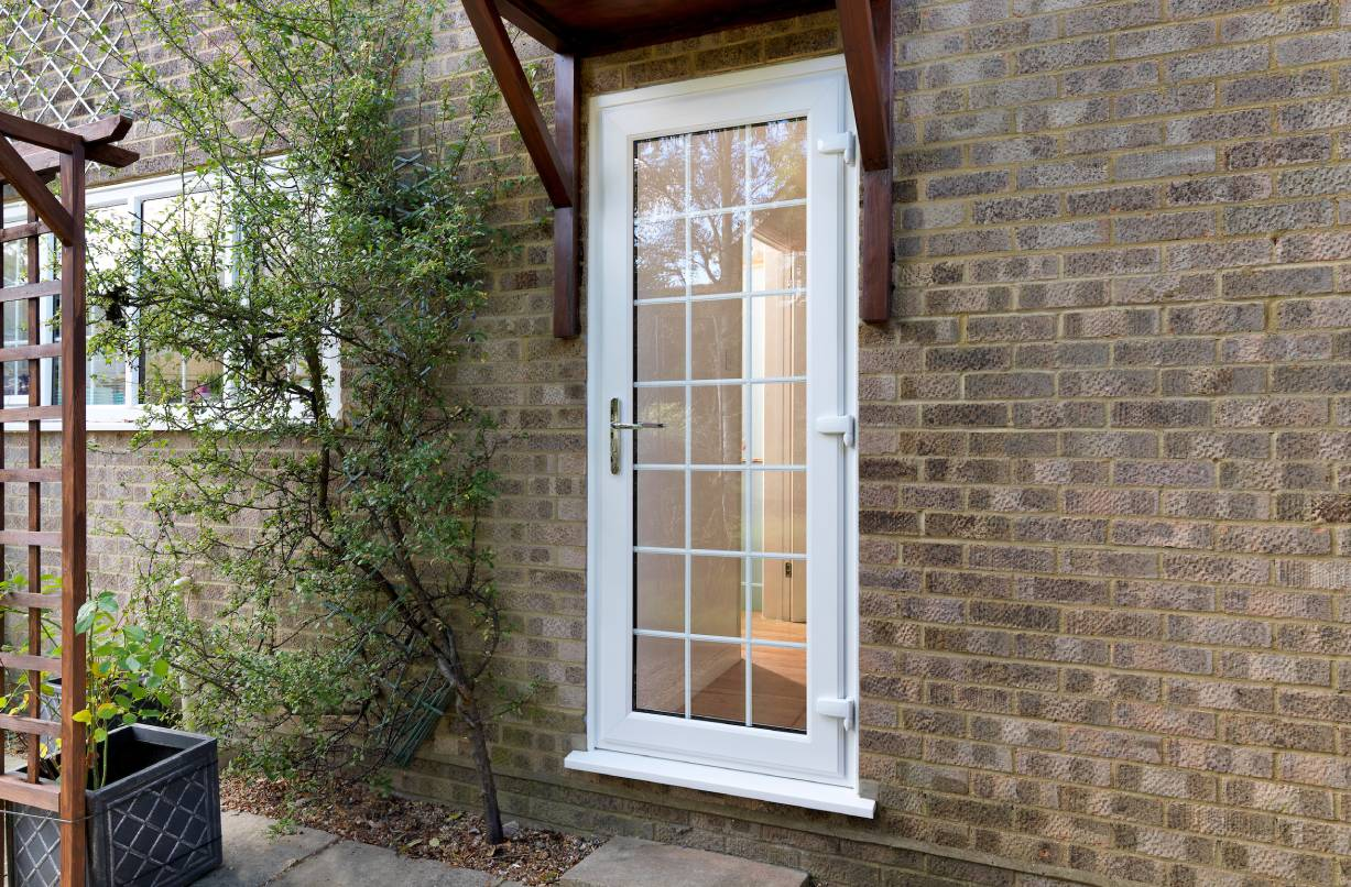 A white uPVC back door with double glazing