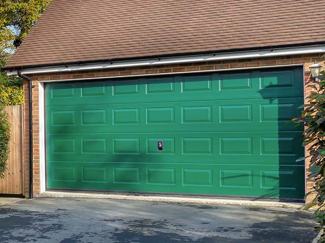 Side angled view of a Racing Green Everest Sectional Garage Door