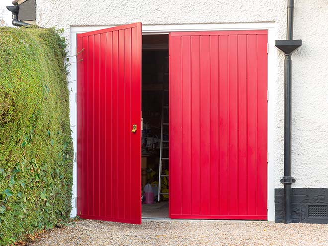 Front view of an open Side Hinged garage door in red from Everest