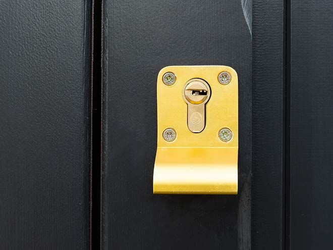 Brass lock on a black Everest Side Hinged Garage Door