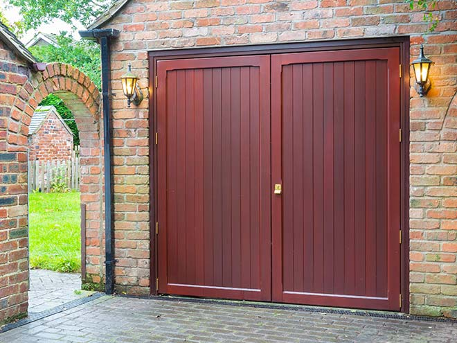 Brown Everest side hinged garage door with brass locks