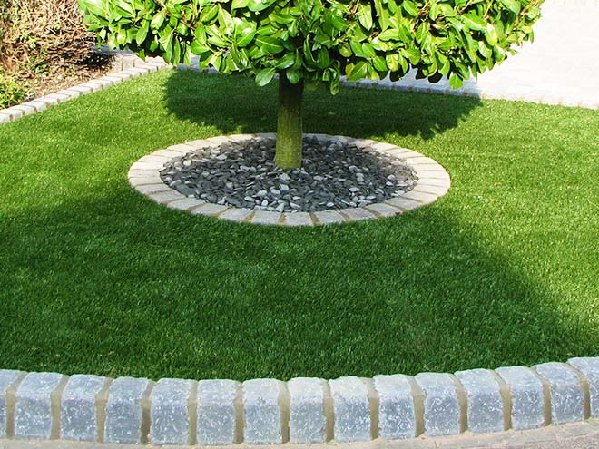 Everest Artificial Grass surrounding a circular plant
