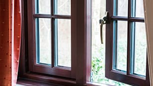 Brown wood casement window