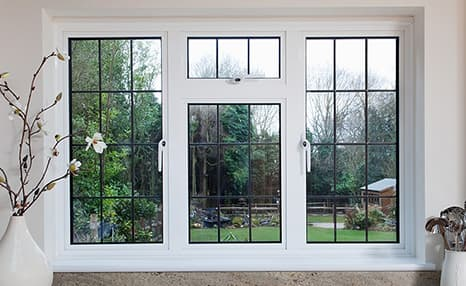 A white uPVC tilt and turn window seen in tilt position which allows for secure ventilation