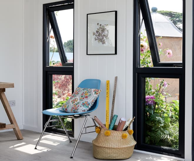 Black slimline aluminium windows give a contemporary feel to your home