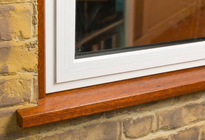 Aluminium casement window in white with a timber sub frame