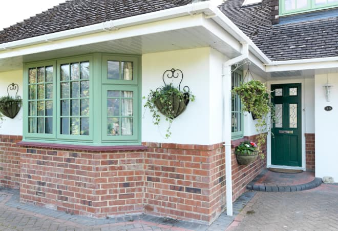 Stunning uPVC bay windows in chartwell green
