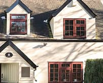 Brown Everest timber casement windows on a cottage
