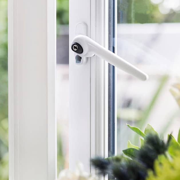 Close up of a white modern handle on a white Everest casement window