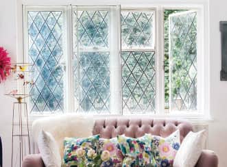 A stylish original framed window in white with new secondary glazing to prevent heat loss