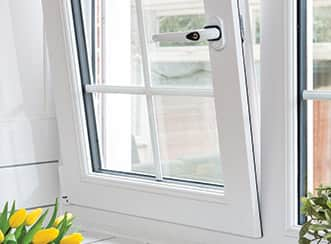 A new tilt and turn window in white opened in the tilted position