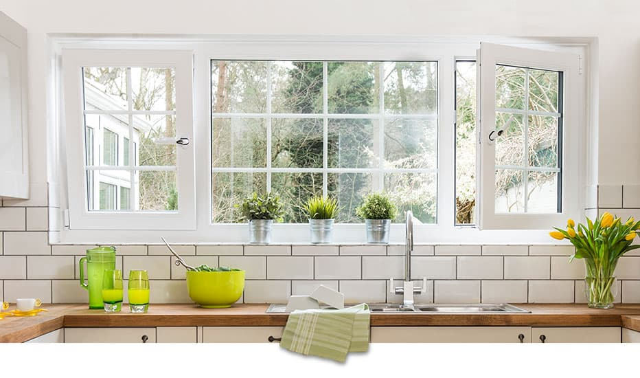 A large white tilt and turn window in a kitchen with one window tilted and the other turned inwards