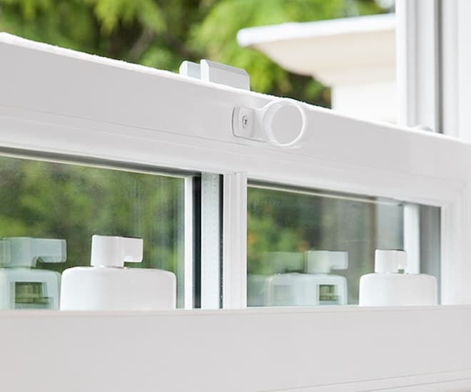 Close up of an Everest white uPVC window which adheres to Secured by Design